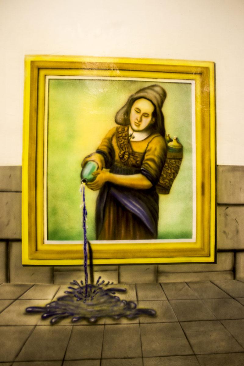 Air tumpah dari lukisan